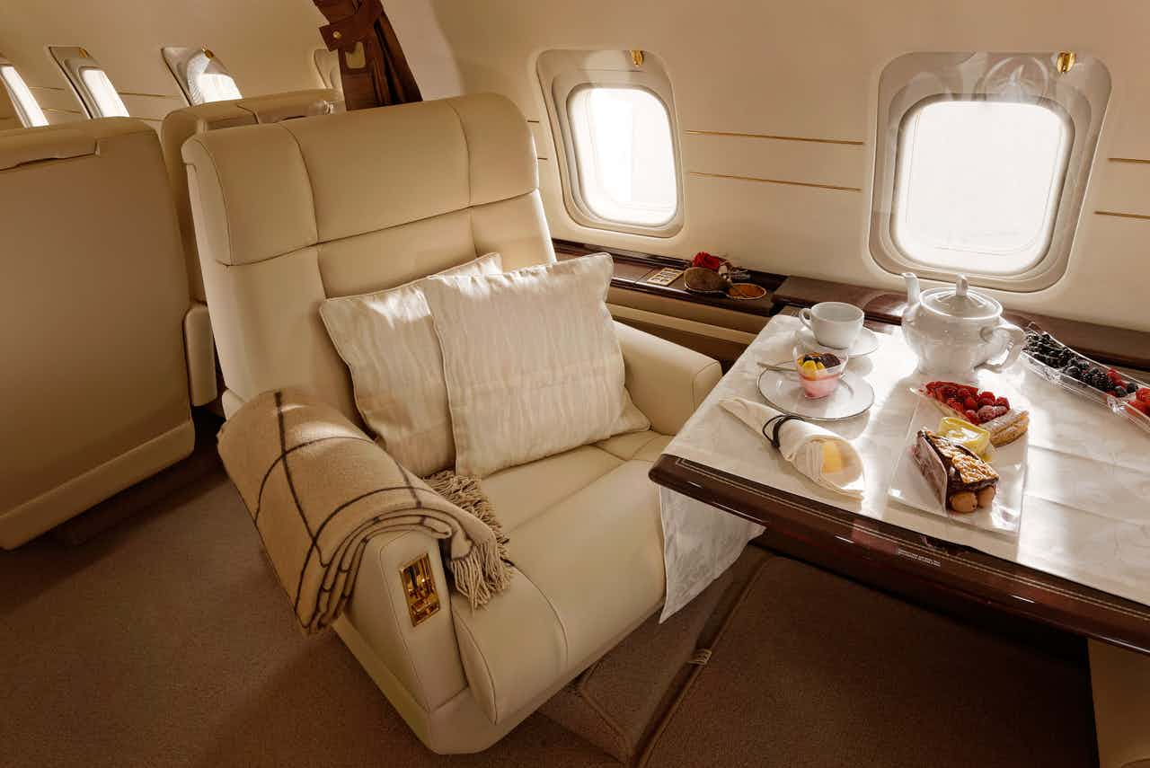 Elegant aircraft interior with beautiful desserts served